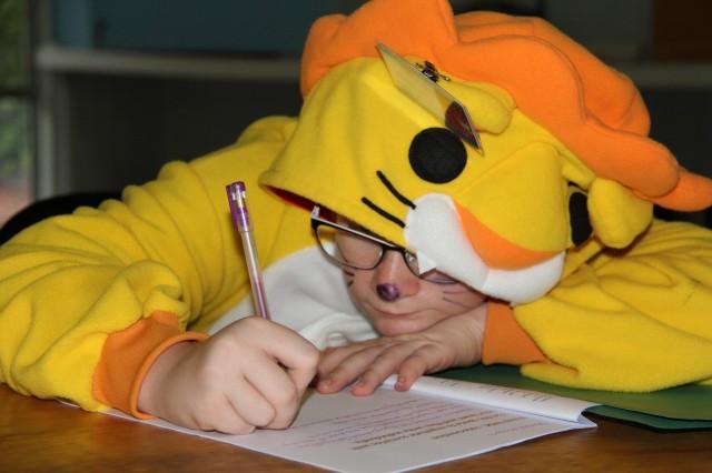 Aslan writing furiously